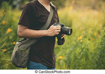 professional photographer with camera.