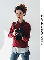 professional photographer with digital photo camera