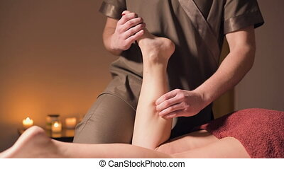 Professional physiotherapist male masseur in an office with ...