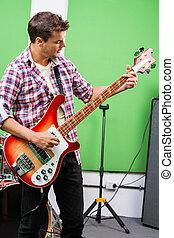 Professional Playing Guitar In Recording Studio
