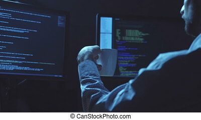 Professional programmer writing a programming code