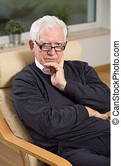 Portrait of professional psychoanalyst at his office