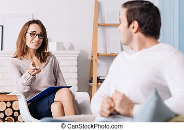 Professional psychologist talking with her client