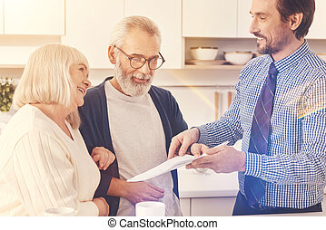 Professional real estate agent working with retired couple