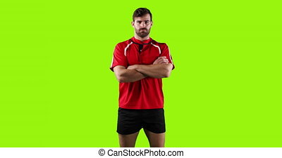 Professional rugby player standing with crossed arms 4k