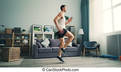 Professional runner exercising at home running on the spot...