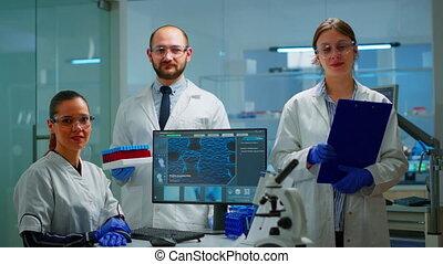 Professional scientific medical staff looking at camera
