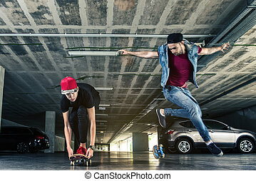 Professional skateboarders jumps in the subway