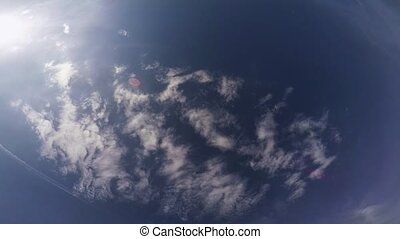 Professional skydiver fly in cloudy sky, open parachute....