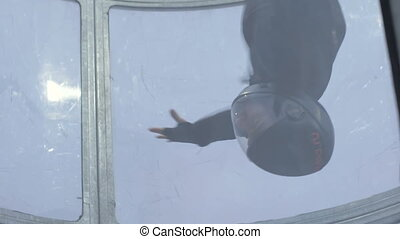 Professional skydiver flying in wind tunnel. Training jumping with a parachute