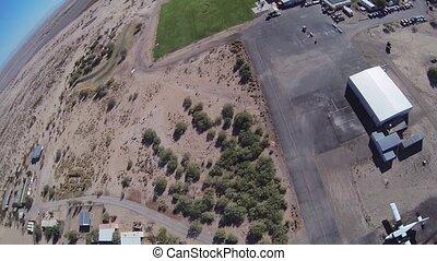 Professional skydiver parachuting above arizona. Landscape....