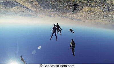 Professional skydivers parachuting above coast of Dubai....