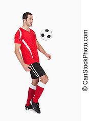 Professional soccer player kicking ball