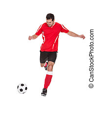 Professional soccer player kicking ball. Isolated on white
