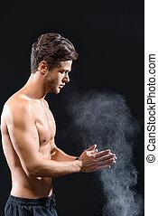 Professional sportsman applying powder on arms