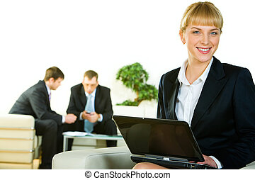 Professional - Photo of employee looking at camera and...