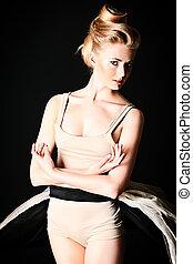 professional - Beautiful ballet dancer posing at studio.