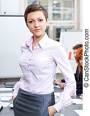 professional successful business woman in office smiling