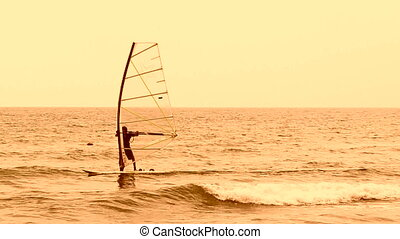 Professional surfer is maneuvering - A surfer is floating on...