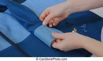 Professional tailor, designer measuring suit jacket for sewing at atelier