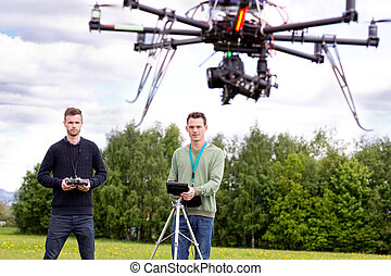 UAV Photography Drone - Professional team of a photographer...