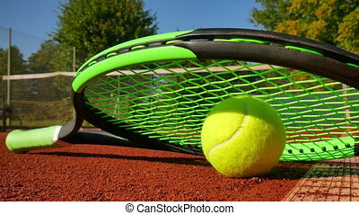 Professional tennis racket and a ball, close up