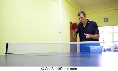 Professional tennis training - Table tennis player at...