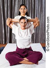 Thai massage stretch - professional Thai massage stretch