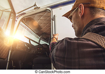 Professional Truck Driver Getting Into a Truck