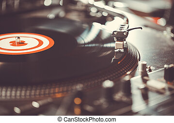 Turntable vinyl record player, analog sound technology for DJ playing analog and digital music. Close up, macro of equipment for professional studio, concert, event.