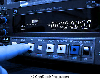 Finger pushing button on a professional vcr