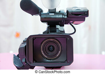 Professional video camera isolated. Professional full HD camcorder