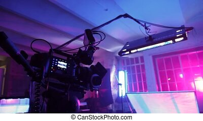 Professional videocamera with display, lamp and reflecting ...