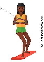 Professional wakeboard sportswoman. - An african-american...