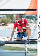 professional waterman training on lake with catamaran