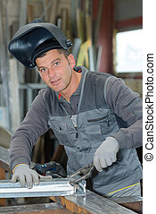professional welder during his shift in the factory