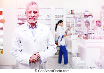 Professional wise pharmacists working in a drugstore