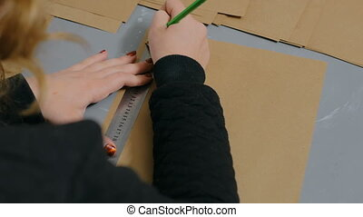 Professional woman decorator, designer working with kraft paper