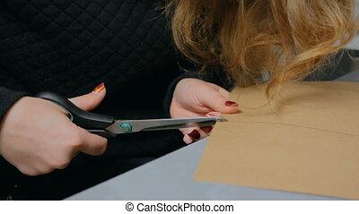 Professional woman decorator, designer working with kraft paper