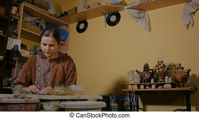 Professional woman potter preparing clay for work