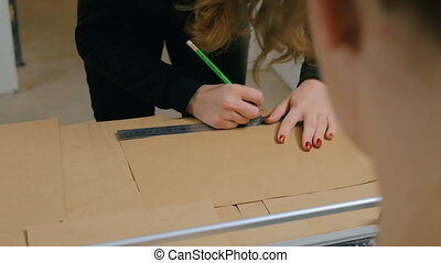 Professional women decorator working with kraft paper - Two...