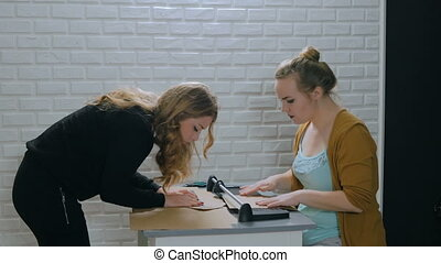 Professional women decorators working with kraft paper - Two...