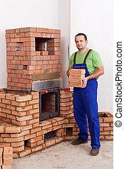 Professional worker building masonry heater
