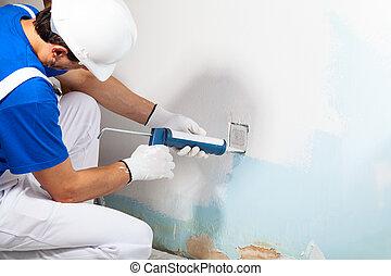 Professional Workman Applying Silicone Sealant With Caulking Gun