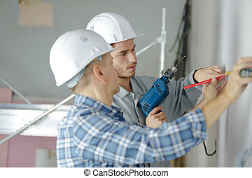 professional workmen working on a wall