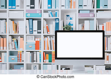 Professional workspace with computer and shelves