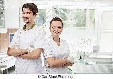Professional young dentists are working in lab