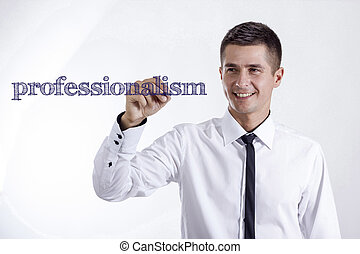 professionalism - Young smiling businessman writing on transparent surface