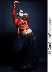 fashion young woman on dark background