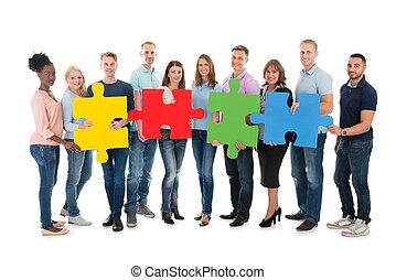 professionnels, puzzle, créatif, tenue, morceaux